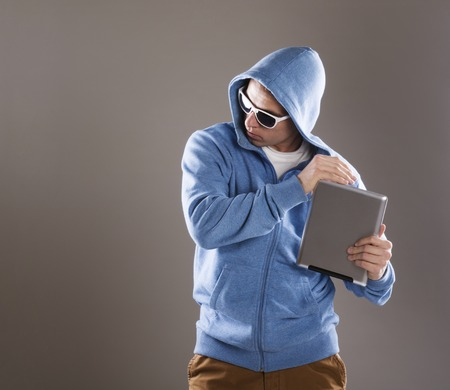 Dangerous man in mask with tablet on isolated background photo