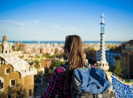 guell: Rear view of young female tourist looking at view in Parc Guell in Barcelona, Spain