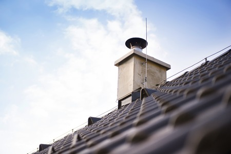 waterproofing: Chimney stack and concrete roofing on the new building Stock Photo