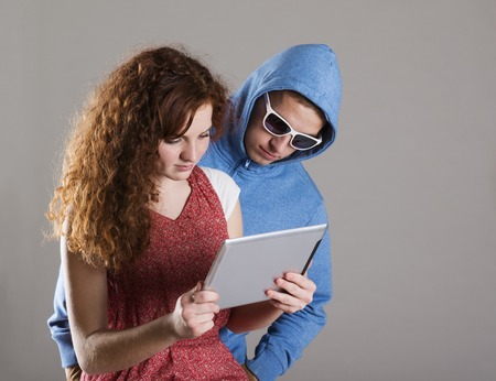 Concept of potentional internet danger with teen girl amd man in disguise photo