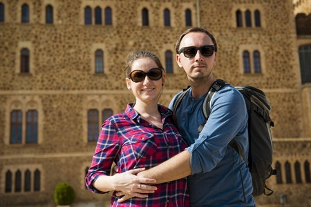 Happy young tourist couple is enjoying vacation in Barcelona, Spain  photo