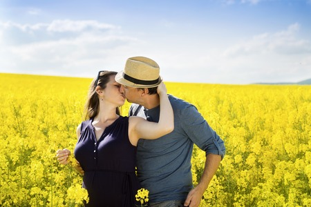 Spring outdoor portrait of young pregnant couple photo