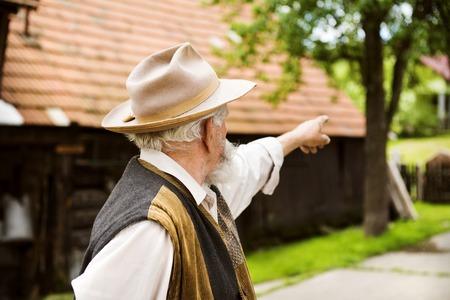 agriculturalist: Senior man pointing