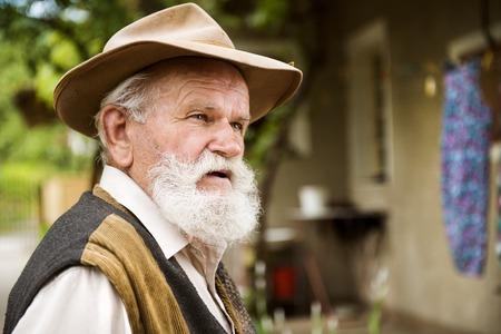 agriculturalist: Senior man looking somewhere