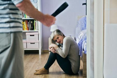 beaten: Domestic violence Stock Photo