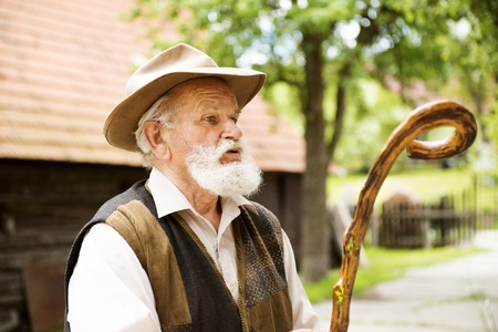 agriculturalist: Old man looking somewhere Stock Photo