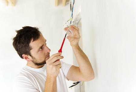 maintenance fitter: Electrician working Stock Photo
