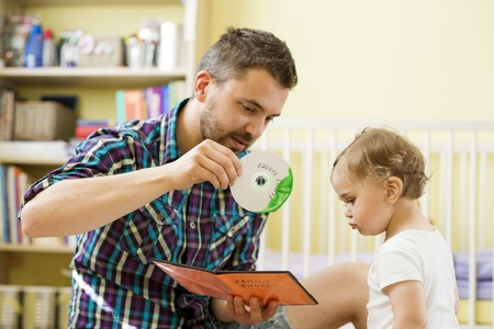 sleazy: Father with damaged CD and his little daughter Stock Photo