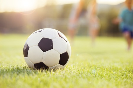 soccer ball on grass: Father and child