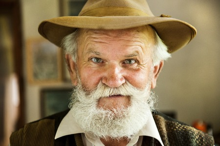 old man portrait: Portrait of old farmer with beard and hat