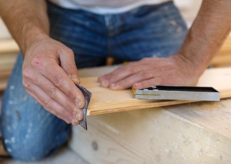 redesign: Handyman installing wooden floor in new house Stock Photo