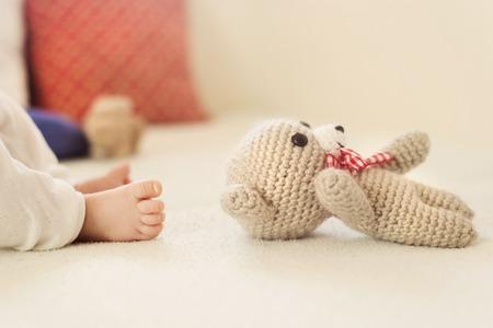 Close up of newborn baby girl s feet photo