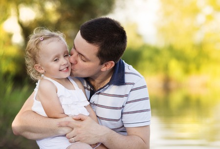 father and daughter: Happy young father spending time with his little daughter in green nature