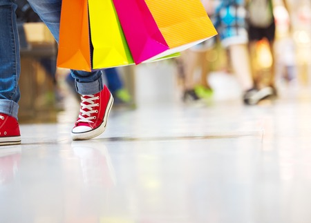 Shopping time, young teenage girl with shopping bags at shopping mall photo