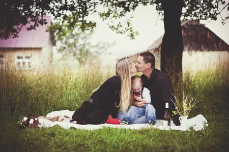 family time: Happy young family spending time together in green nature