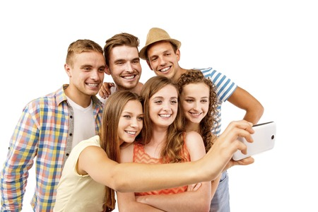 boy friend: Group of happy young teenager students taking selfie photo isolated on white background