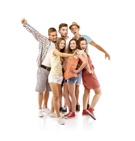 group picture: Group of happy young teenager students taking selfie photo isolated on white background