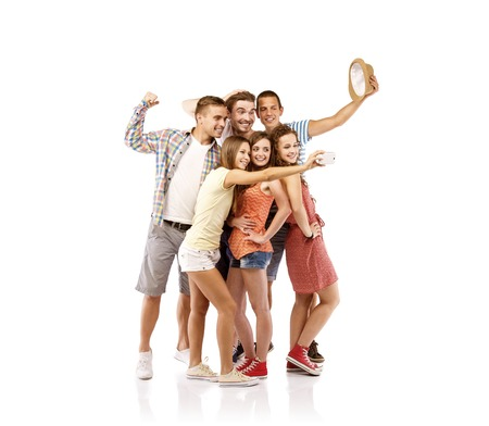 Group of happy young teenager students taking selfie photo isolated on white background photo