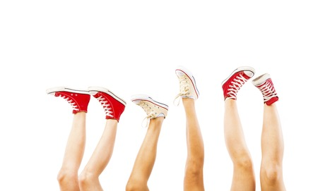 Students feet concept with sneakers on white background with space for text photo