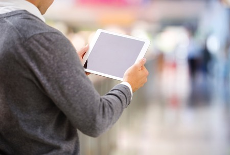 old pc: Detail of man hands holding tablet in shopping centre