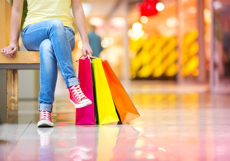 fashion bag: Shopping time, closeup of teenage girl s legs with shopping bags at shopping mall Stock Photo