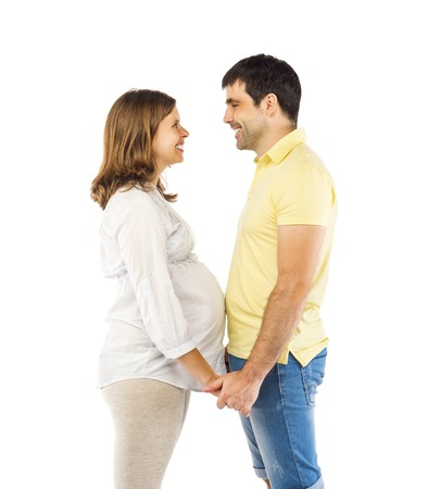 Beautiful young happy smiling pregnant couple, isolated on white background photo