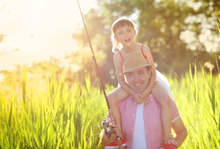 weekend activities: Happy young father with his little daughter going fishing Stock Photo