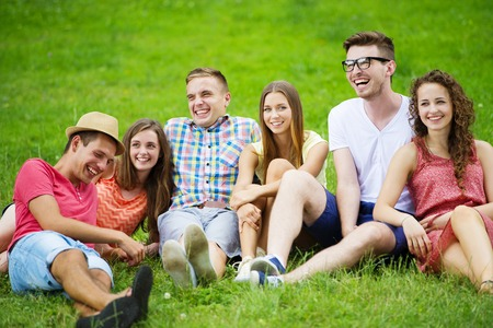 people having fun: Group of young people having fun in park, sitting on the grass