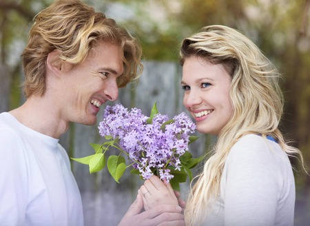 Spring outdoor portrait of young happy couple photo