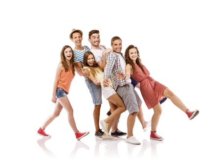 Group of happy young teenager students having fun, isolated on white background  Best friends photo