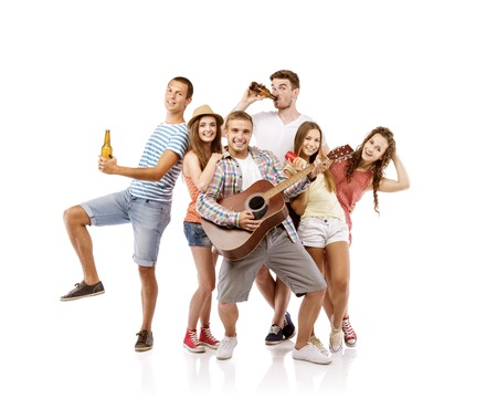 Group of happy young people having fun with guitar, isolated on white background  Best friends photo
