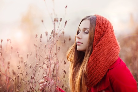 Portrait of beautiful girl with scarf in autumn nature photo
