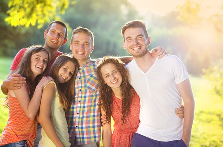 people having fun: Group of young people having fun in park Stock Photo