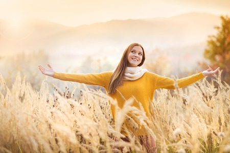 Portrait of beautiful girl with scarf in yellow autumn nature photo