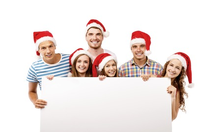 Group of young people in santa hats with copy space, isolated on white background photo