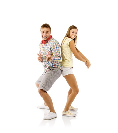 Smiling young people dancing, isolated on white background photo