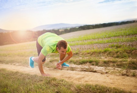 tripping: Male runner tripping over and falling down on the cross country trail Stock Photo