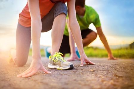 preparing: Runner feet. Running couple closeup of running shoes.
