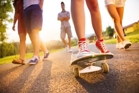Closeup of legs and sneakers of young people on skateboard photo