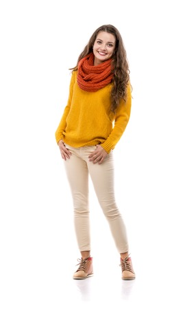 yellow fleece: Beautiful girl in autumn clothes posing in studio, isolated on white background