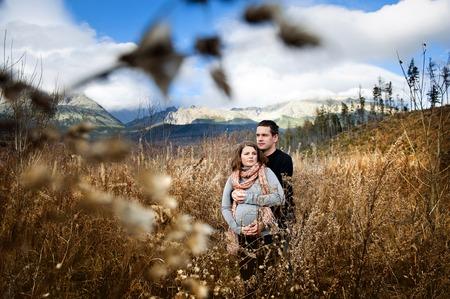 Beautiful outdoor pregnant couple portrait in autumn nature photo