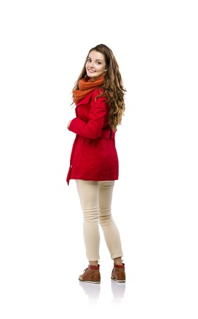 Beautiful girl in autumn clothes posing in studio, isolated on white background photo
