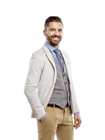busy beard: Studio shot of modern hipster businessman, isolated on white background