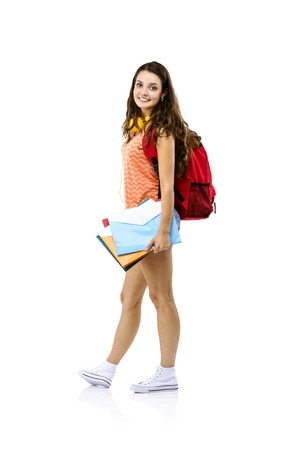 Beautiful young student girl with bag holding folders, isolated on white background photo