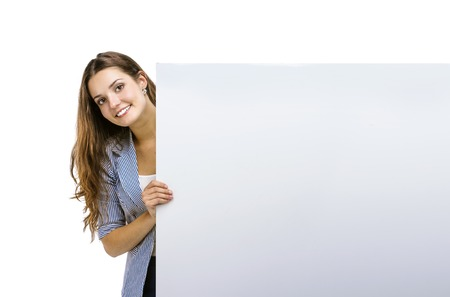banner ad: Successful business woman is standing and holding blank banner, isolated background. Stock Photo