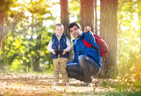 Father and son enjoying a walk in the forest photo