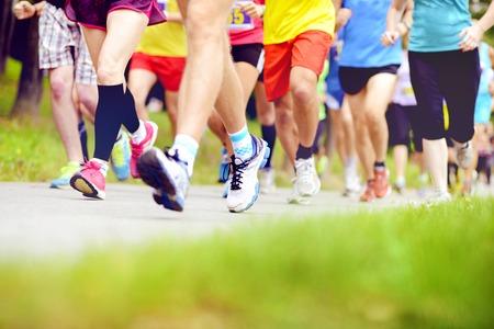 Group of unidentified marathon racers running, detail on legs