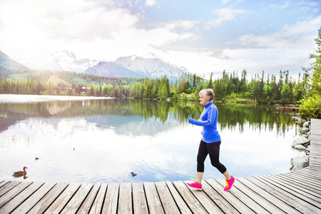 old woman: Senior woman running