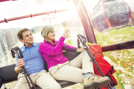 guy with walking stick: Senior couple with hiking equipment  Stock Photo