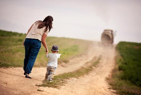 healthy path: Happy mother with little boy walking in ntaure